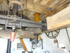 Great spur wheel, stone nut, bridgetree and upright shaft support frame, tower mill, Wilton
