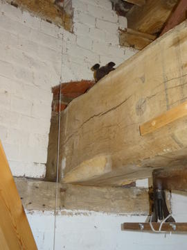 Mounting of bridge beam in wall, tower mill, Quainton
