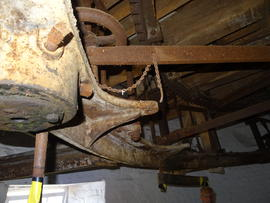 Great spur wheel, stone nuts, tentering bars and support girder for stone spindles, tower mill, O...