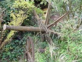 Windshaft, brakewheel spider and winding gear on ground, Beacon Mill, Benenden