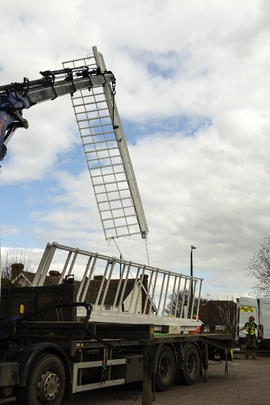 Crane lifting the first sail, Rayleigh Windmill