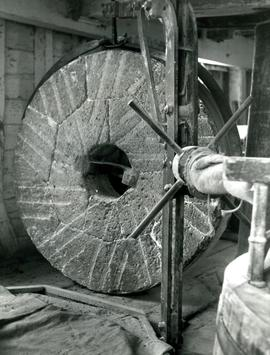 Woodbridge Tide Mill, Suffolk, lifting millstone for dressing
