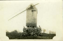 French soldiers beside a post mill