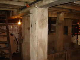 Meal ark and spouts, also showing vertical posts supporting stone floor, Lacey Green Windmill, La...