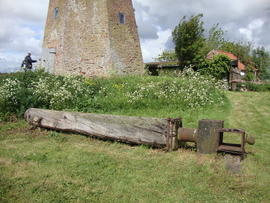 Windshaft on ground, with mill tower in background, Sneath's Mill, Lutton Gowts