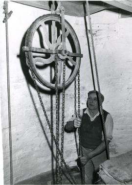 North Leverton Tower Mill, Nottinghamshire, Miller Bill Heathershaw using the sack hoist