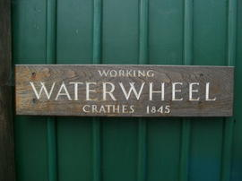 Alford Heritage Centre near Aberdeen, Scotland, showing waterwheel rescued from Crathes