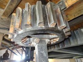 Great spur wheel and nut of quant of stones on spout floor, Heckington Windmill, Heckington