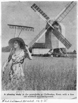 """Photograph of Chillenden Windmill and girl with hay rake"""