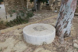 Millstone in the courtyard of the Venetian Palace ruins, Famagusta