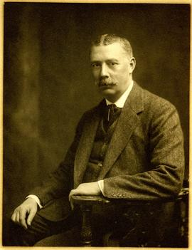 H Ridley Esq. Posing for photographic portrait