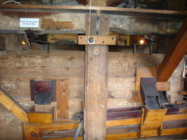 Boarded-in upright shaft support frame incorporating meal spouts, Upminster Windmill, Upminster