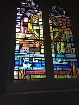 Stained glass window showing Houghton Mill