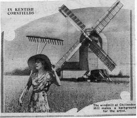 """In Kentish Cornfields - The windmill at Chillenden Hill makes a background for the artist"""