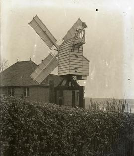 E Lancaster Burne's small homemade corn mill at his home in Guildford, Surrey