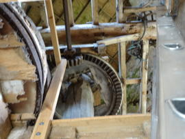 Looking up onto stone floor at crown wheel, upright shaft and machine drive, Friary Mill, Blakeney