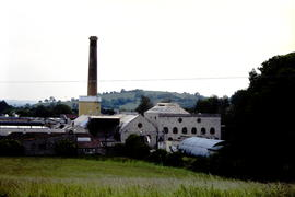 St Cuthberts Mill, Wells, Somerset, from north with tiled laboratory building and leat to left of...