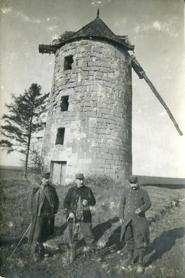 French soldiers beside a tower mill