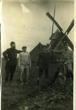 Russian and French soldiers pose next to a miller and his son