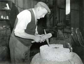 Miller working at a millstone