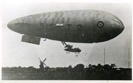 British airship SST2 with a smock mill in background