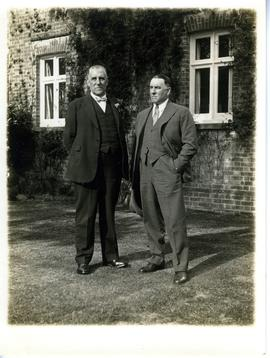Two men posing for picture