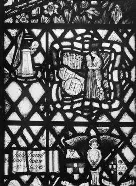 Stained glass window with smock mill
