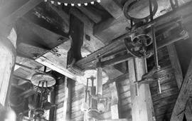 """Interior view of windmill showing governor and tentering gear, Henfield, Sussex"""