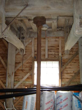 Engine drive upright shaft (and note unusual diagonal framing in background), smock mill, West Ki...