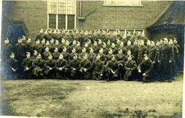 Employees group photograph in their military uniforms