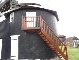 Main roundhouse, showing access ladder to upper storey, Windmill Hill Mill, Herstmonceux