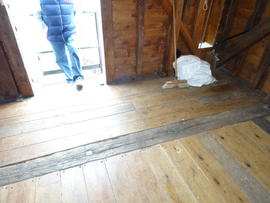 Flooring of spout floor showing original threshhold beam, Windmill Hill Mill, Herstmonceux