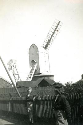 Two children outside of a post mill in Friston, Suffolk
