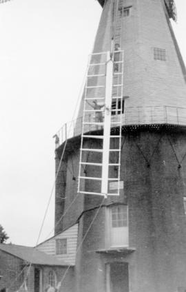 Raising a new sail during restoration, Union Mill, Cranbrook