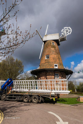 Truck with new sails backing into position in front of Rayleigh Windmill