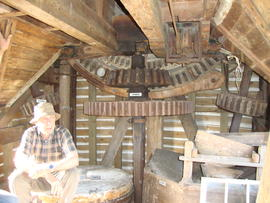 Brakewheel, head wallower, upright shaft, great spur wheel and stone nuts, post mill, Ramsey
