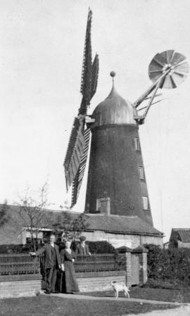 Unidentified tower mill with the miller and his wife