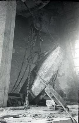 """Bradwell, Bucks - windmill interior with millstone and lifting tackle"""