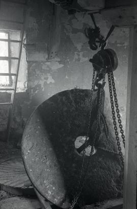 """Bradwell, Bucks - interior of windmill showing millstone and lifting tackle"""