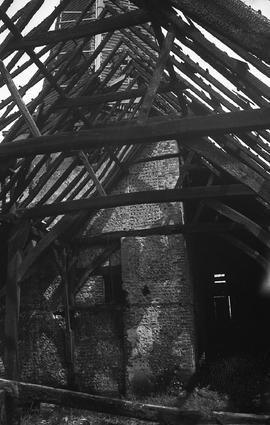 """View of windmill through roof timbers of barn, West Blatchington, Sussex"""
