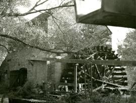 Cheddleton Flint mill exterior showing waterwheel