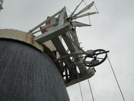 Looking up at cap, fantail, fanstage, winding and striking gear, tower mill, Thelnetham