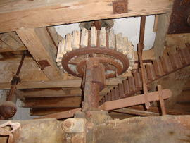 Great spur wheel, stone nut, governor and tentering gear, tower mill, Old Buckenham