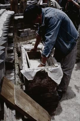 Sanba. Lifting mould from vat.
