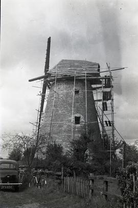 """Bradwell, Bucks - repair of cap"""