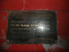 Security plaque on door
