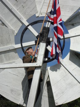 Fixing Union Jack to fantail, post mill, Holton St Peter