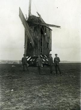 German soldiers beside a destroyed post mill
