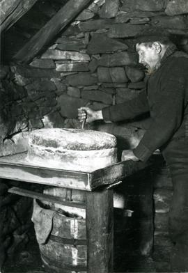 Quern in use at mill in Shetland