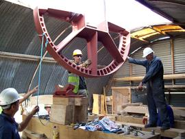 Half of brakewheel being lifted out of workshop, Hardley Mill